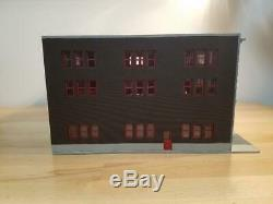 1/64 scale Manhattan Fire station for code 3's. Built and ready as pictured
